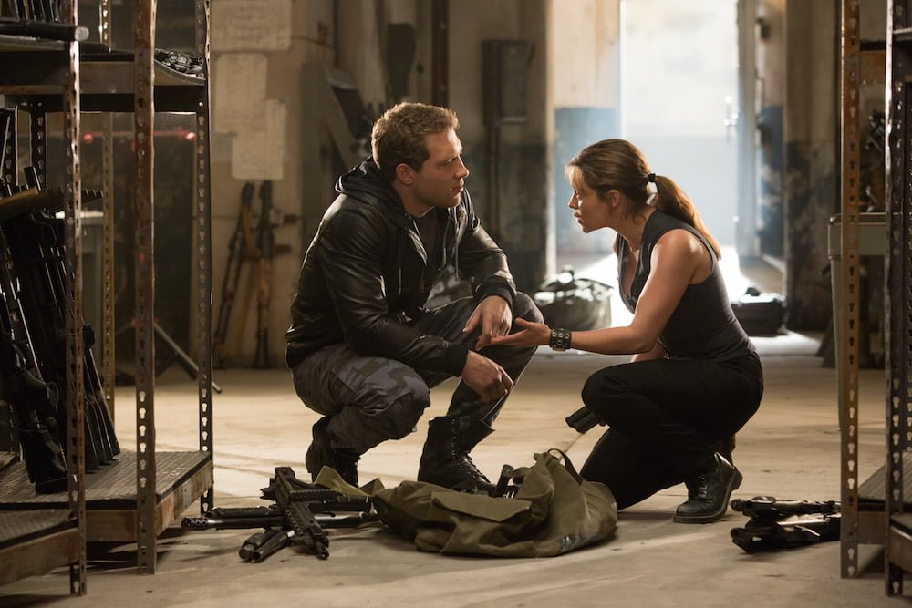 Left to right: Jai Courtney plays Kyle Reese and Emilia Clarke plays Sarah Connor in Terminator Genisys from Paramount Pictures and Skydance Productions.